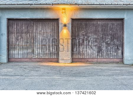 Pair of Garage Doors with a light between them.