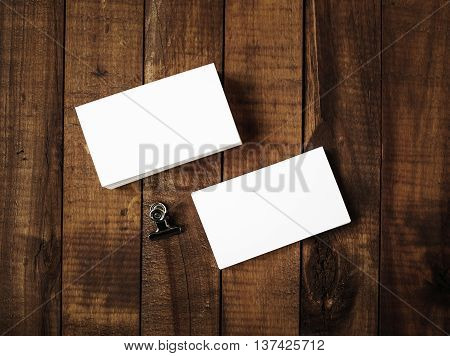 Photo of blank business cards on a wooden background. Template for ID. Top view.