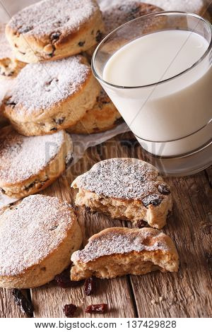 Freshly Baked Welsh Cakes With Raisins And Milk Close-up. Vertical