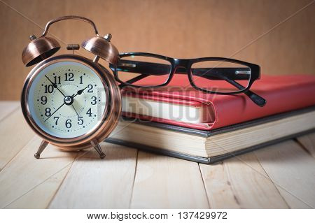 Retro Alarm Clock And Book.