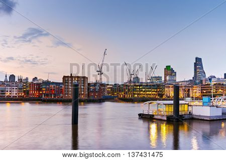 Night Cityscape of London near Millennium Footbridge and Thames river, London, England, Great Britain