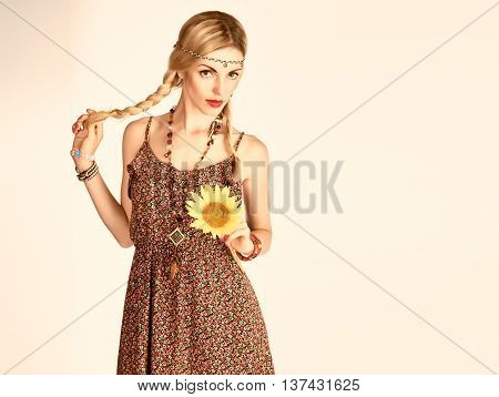 Hippie Boho woman Having Fun. Playful positive Model Summer Fashion Outfit. Happy Blonde, Trendy Sundress with sunflower, Fashion Boho Accessories. Boho romantic fashion Summer Style. Unusual creative