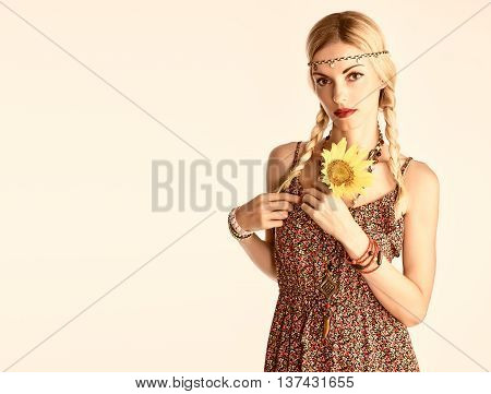 Hippie Boho woman Having Fun. Playful positive Model Summer Fashion Outfit. Happy Blonde, Trendy Sundress with sunflower, Fashion Accessories. Boho romantic fashion Summer Style. Unusual creative look