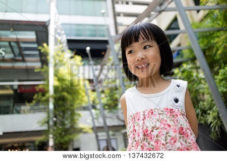 Asian Chinese little girl smiling with building background
