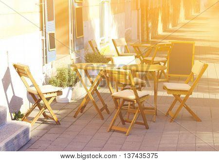 Empty cafe terrace in bright sunlight