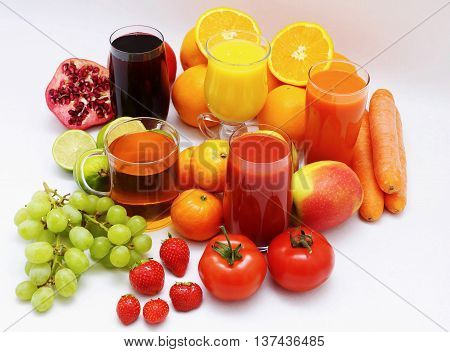 Organic fruits and fruit juice on white background