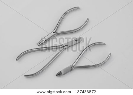 Dentist tools isolated on white. Selective focus