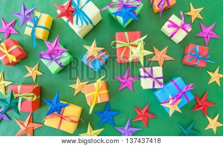 Little colorful presents for christmas on green