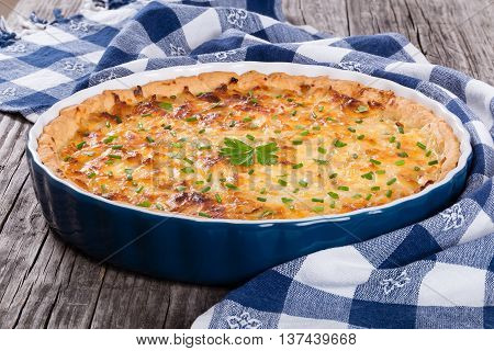 French onion quiche or pie in a gratin dish traditional recipe view from above