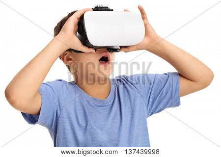 Amazed boy experiencing virtual reality isolated on white background