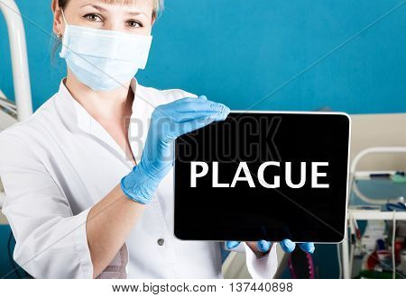 technology, internet and networking in medicine concept - femail dentist holding a tablet pc with plague sign. at the dental equipment background.