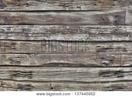 Old Weathered Wooden Stacked Plank Wall Background. Aged Wood Texture. Gray Background