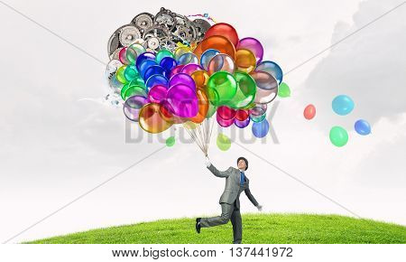 Comedian man with color balloons . Mixed media