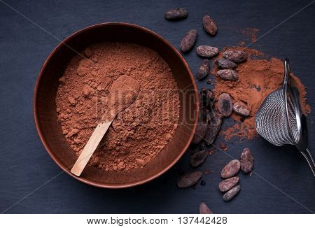 Cocoa Powder In A Bowl And Cocoa Beans