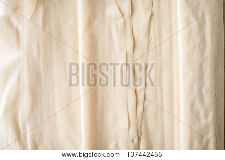 Filo dough sheets background horizontal close- up