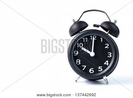 Black double bell alarm clock showing ten o'clock on white background
