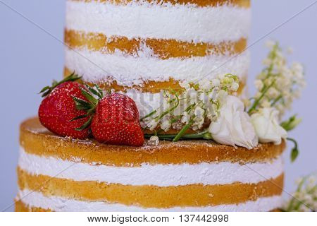 Beautiful wedding cake with strawberries close-up. Food