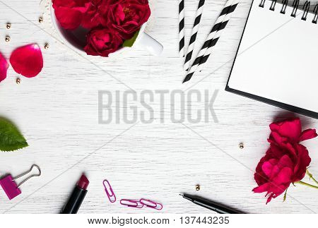 Pretty feminine stuff on the white background with negative space top view