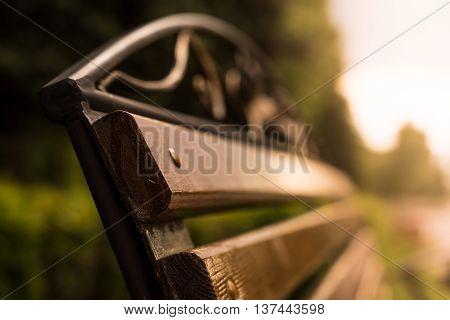 Fragment of bench horizontal fragment, blur metal