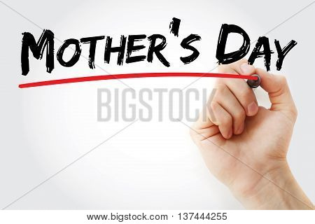 Hand writing Mother's Day with marker concept background
