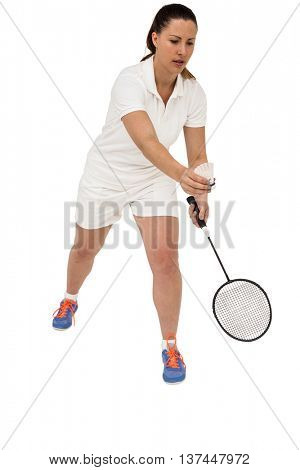 Female athlete holding a badminton racquet ready to serve on white background
