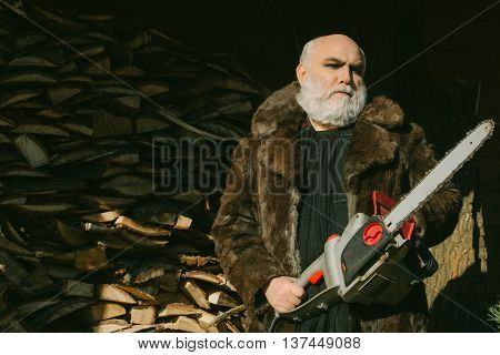 Old Bearded Man With Chainsaw