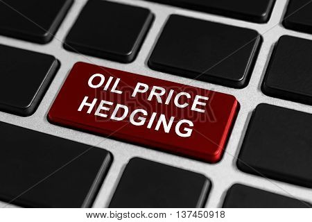 oil price hedging button on keyboard business concept