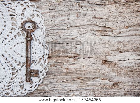 Vintage Background With Old Key And Lace On Wood
