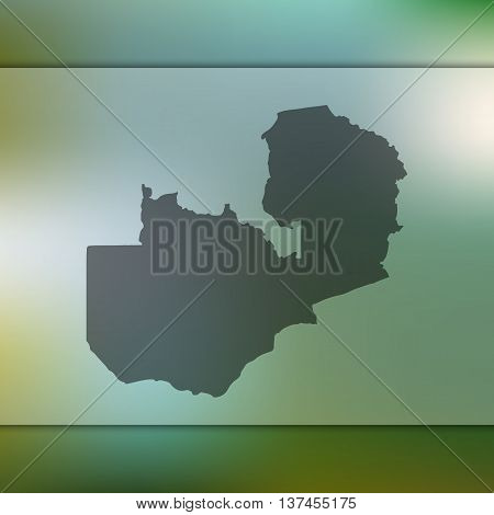 Blurred background with silhouette of Zambia. Zambia map.
