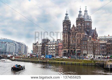 Amsterdam, Netherlands - March 31, 2016: Basilica, church of St. Nicholas in Amsterdam, near railway station
