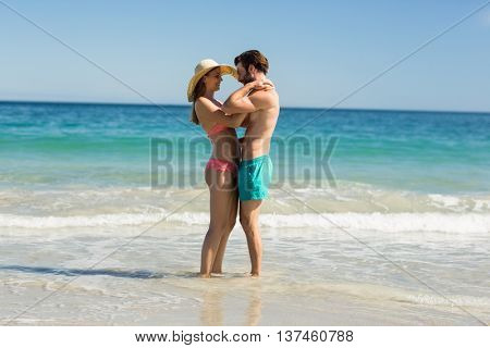 Young couple embracing each other on beach