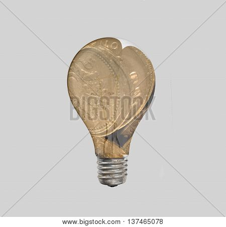 Shiny British Pound coins in off lightbulb