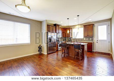 Kitchen Mahogany Storage Combination With Steel Kitchen Appliances And Back Splash Trim