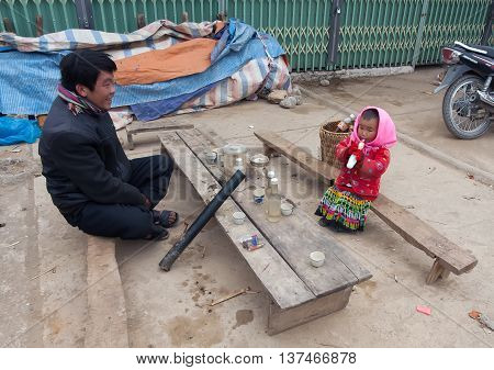 HA GIANG, VIETNAM, February 2, 2016: Hmong father and daughter, Ha Giang mountainous regions, they are happy with small children, at the bazaar Dong Van, Ha Giang mountainous region, Vietnam