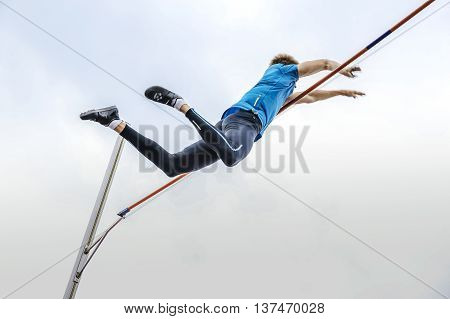 male athlete high jump pole vault during athletics competitions