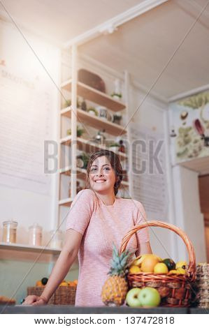 Smiling Juice Bar Owner Standing Behind The Counter