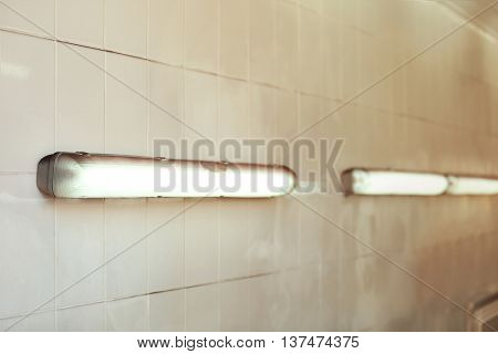 Fluorescent light tube on a wall with copy space