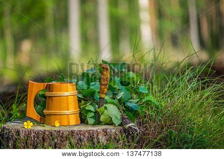 Still-life in forest about Finnish sauna equipment