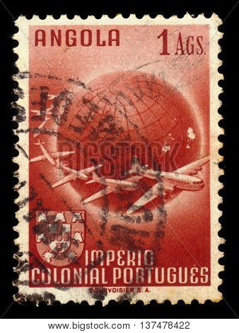 Angola - CIRCA 1949: a stamp printed in Portugal shows planes circling globe, series, circa 1949