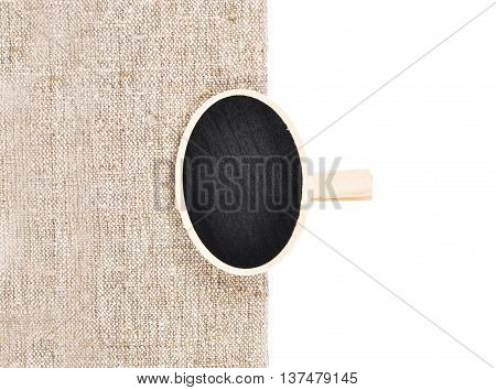 Colorful and crisp image of board with wooden peg on linen