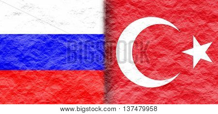 Image relative to politic relationships between Russia and Turkey. National flags textured by crumpled paper