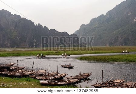 Ninh Binh, Vietnam, July 6, 2016 tourists, boating, sightseeing visits. Biosphere Reserve World, Van Long, Ninh Binh, Vietnam