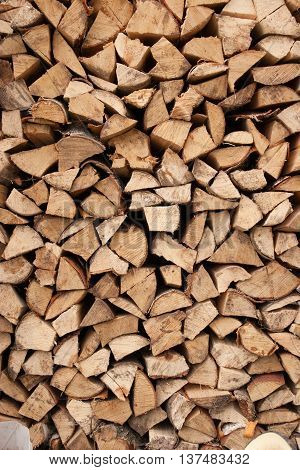 Stacked chopped firewood prepared for winter as background