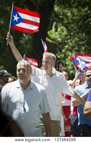 NEW YORK - JUNE 12 2016: New York City Mayor Bill De Blasio marches in the 59th annual National Puerto Rican Day Parade on 5th Avenue in New York City on June 12 2016.