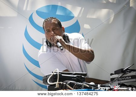 NEW YORK - JUNE 12 2016: A DJ uses a microphone to speak to the crowd during the 59th annual National Puerto Rican Day Parade on 5th Avenue in New York City on June 12 2016.