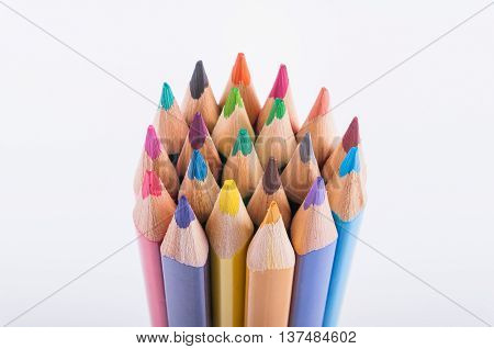 Colorful pencils in a grup isolated on a white background