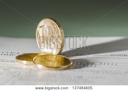 10 Russian Rubles, Coins Lie On Documents Accounting. Documents For Payment.