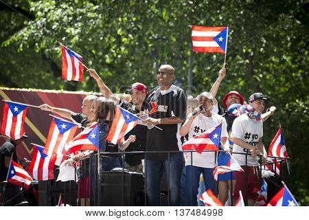 NEW YORK - JUNE 12 2016: DJ Lobo, Rapper Vico C. and other DJs of X96 Radio Station wave flags and celebrate at the 59th annual National Puerto Rican Day Parade on 5th Ave in Manhattan June 12 2016.