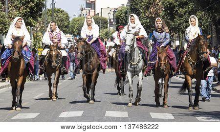 SELARGIUS, ITALY - September 14, 2014: Former marriage Selargino - Sardinia - group of women in Sardinian costume parade on horseback