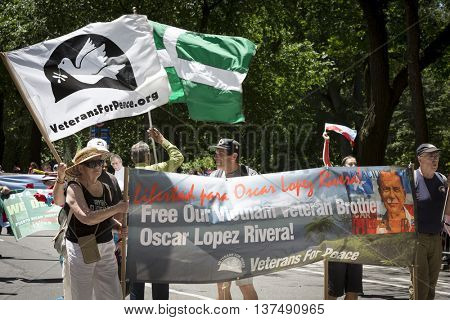 NEW YORK - JUNE 12 2016: Members of Veterans For Peace march with a Free Our Vietnam Veteran Brother Oscar Lopez Rivera banner in the 59th National Puerto Rican Day Parade on 5th Avenue in NYC.